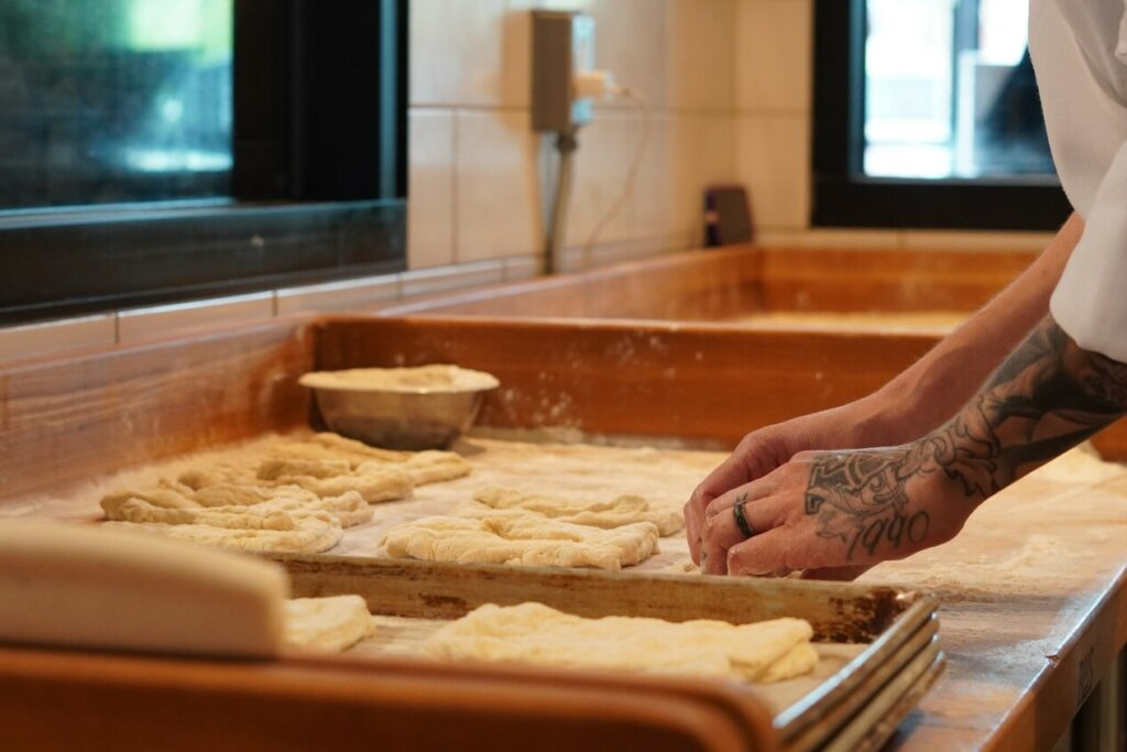 baker creating fresh baked goods